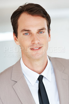Buy stock photo Portrait of a smart young businessman in suit looking confidently