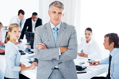 Buy stock photo Portrait of a confident senior business man at meeting colleagues sitting at the back