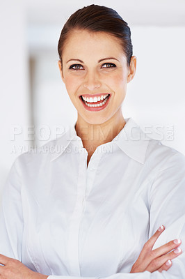 Buy stock photo Portrait of a successful young businesswoman smiling with folded hands at office