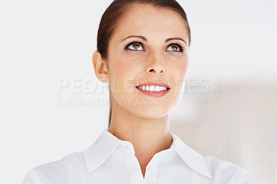 Buy stock photo Portrait of a cute young business woman looking upward at copyspace
