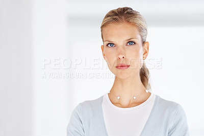Buy stock photo Portrait of a successful young businesswoman standing confidently at you