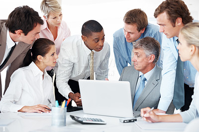 Buy stock photo Discussing new working ideas - Diverse business group in a meeting using laptop at office