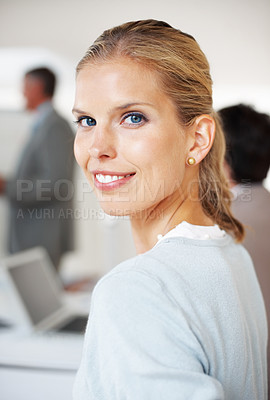 Buy stock photo Closeup portrait of a smart young businesswoman attending a meeting with her colleagues at office