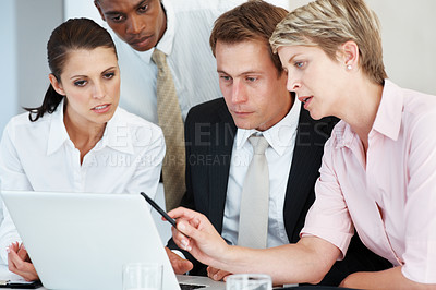 Buy stock photo Successful team of business colleagues working on a laptop and discussing project at office