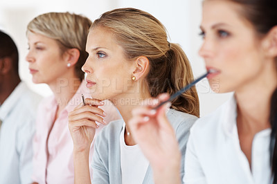 Buy stock photo Confident young businesswoman attending a meeting with her colleagues