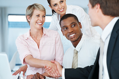Buy stock photo Portrait of a smart young bussinesswoman shaking hand with her colleague during a meeting