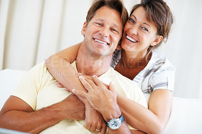 Buy stock photo Portrait of couple smiling with woman hugging man from behind