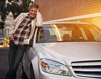 Buy stock photo Portrait of a happy mature man leaning against his car