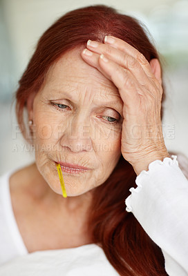 Buy stock photo Portrait of a sick elderly woman with thermometer in her mouth