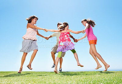 Buy stock photo Full length of family holding hands and circling