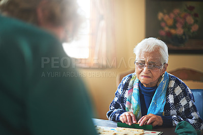 Buy stock photo Cropped shot of seniors playing a boardgame