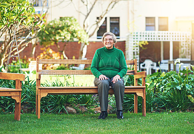 Buy stock photo Portrait of a senior woman sitting on a bench outside