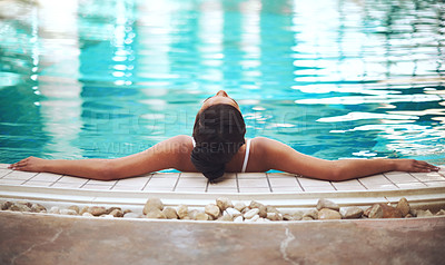 Buy stock photo Shot of a young woman relaxing in the pool at a spa