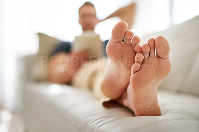 Buy stock photo Shot of a man relaxing on the sofa at home