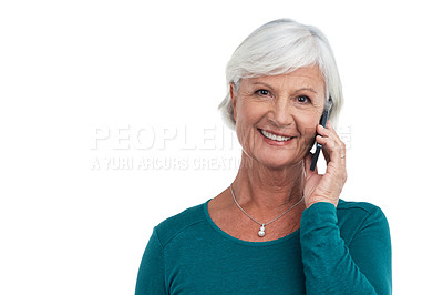 Buy stock photo Studio shot of a senior woman using a mobile phone against a white background
