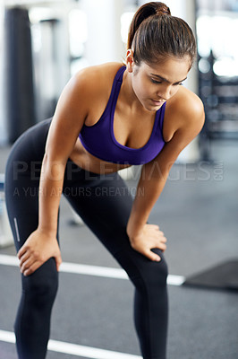 Buy stock photo Cropped shot of a young woman looking tired after a solid workout