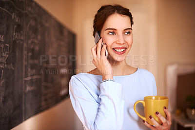 Buy stock photo Cropped shot of a young teacher chatting on her cellphone in a classroom