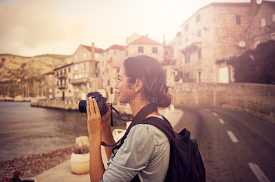 Buy stock photo Shot of a woman taking photos while exploring a foreign city
