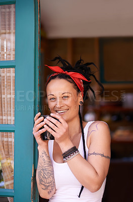 Buy stock photo Shot of a young woman with dreadlocks drinking a cup of coffee at home