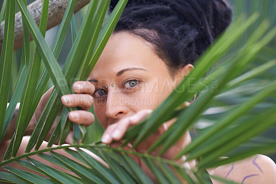 Buy stock photo Portrait of an attractive woman standing amongst the plants in nature