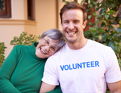 Buy stock photo Cropped portrait of a volunteer spending time with a senior citizen