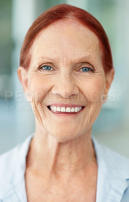 Buy stock photo Closeup portrait of a happy senior redhead giving a cute smile