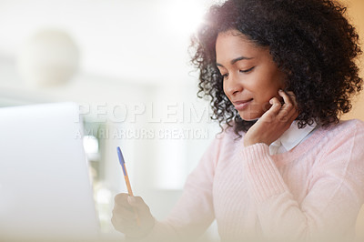 Buy stock photo Cropped shot of a young woman working at home