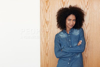 Buy stock photo Cropped portrait of a confident young woman at home