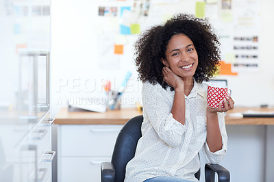 Buy stock photo Portrait of a young businesswoman drinking a beverage in her office
