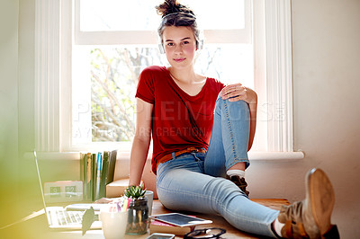 Buy stock photo Shot of a teenage girl relaxing at home with her headphones on