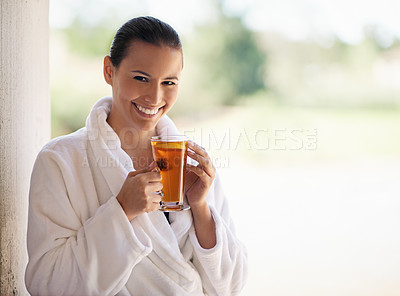 Buy stock photo Shot of a young woman drinking an iced tea at the day spa