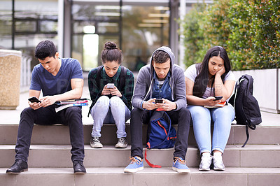 Buy stock photo Shot of a university students on campus