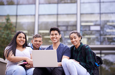 Buy stock photo Portrait of a group of university students using a laptop while sitting on some steps on campus