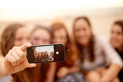 Buy stock photo Shot of girlfriends taking selfies together outdoors