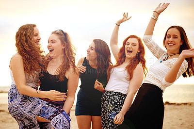 Buy stock photo Shot of a group of girlfriends having fun together outdoors