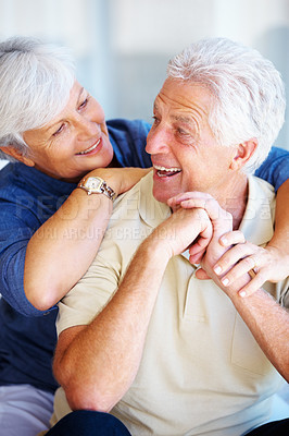 Buy stock photo Senior couple smiling and looking at each other