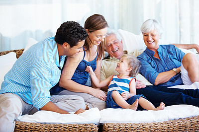 Buy stock photo Family sitting together on a sofa and enjoying the moment