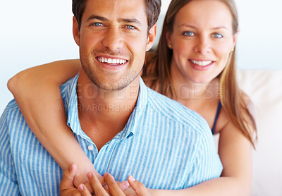 Buy stock photo Closeup portrait of happy couple with woman embracing man from behind