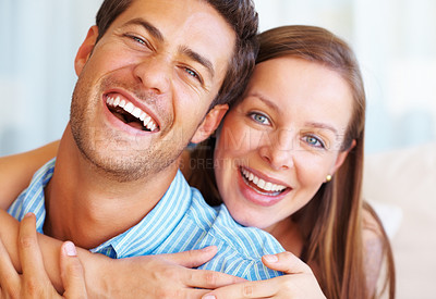 Buy stock photo Closeup portrait of couple giving you an attractive smile with woman embracing man from behind