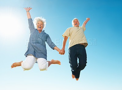 Buy stock photo Full length of senior couple jumping against sky and having fun