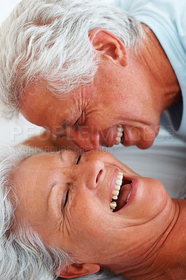 Buy stock photo Closeup of senior couple having a good time in bed