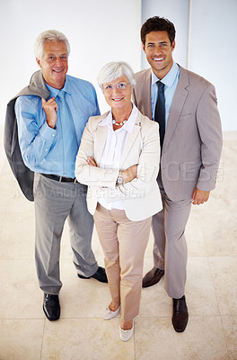 Buy stock photo Portrait of senior female leader with her supporting team standing together