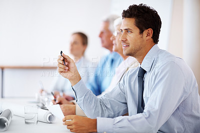 Buy stock photo Smart young business man paying attention in seminar with his colleagues