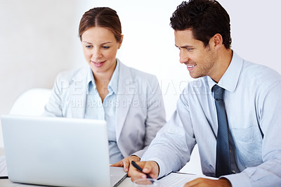 Buy stock photo Portrait of a successful business colleagues working together on laptop in office