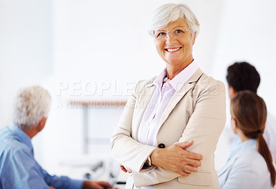 Buy stock photo Portrait of a happy old business woman standing with folded hand at office