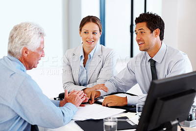 Buy stock photo Business couple in conversation with professional financial consultant during meeting