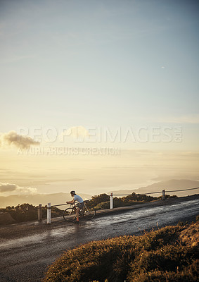 Buy stock photo Full length shot of a young woman sending a text while cycling in the mountains
