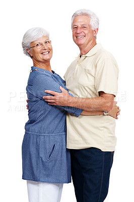 Buy stock photo Portrait of a casual mature couple hugging and smiling isolated over white background