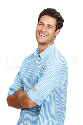 Buy stock photo Portrait of a happy young man standing with arms crossed isolated against white background