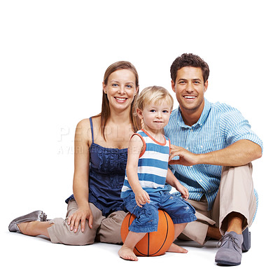 Buy stock photo Cute little kid sitting on a basketball with his parents isolated on white background